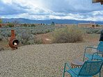 Xeriscaped backyard looking south verifying 180 degree open views + wood burning clay chiminea for year round chilly...