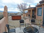View from covered patio to stream, hot tub, sage brush and south mountains
