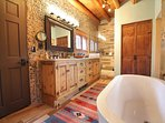 Luxury master bath with 2 way raised gas fireplace, separate walk in shower, soaking tub + private commode closet