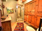 Guest bathroom with dramatic contemporary walk in 'steam shower'