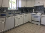Fully stocked kitchen with colorful tiled backsplash and great lighting. Standard appliances incl.