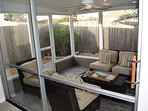Bring the outdoors in with the screen patio.  Open the doors to let the fresh air flow. Ceiling Fan.