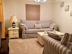 Living room. Queen-size sleeper sofa and matching love seat. TV with video and DVD player.  Board ga