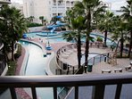 View out our 3rd floor Balcony--Water Park with Slide and Lazy River, two separate pools on outside