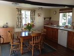 Cottage kitchen with dishwasher, washing machine, fridge/freezer and table for 4.