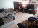 Main leaving area with a 55inches 24hrs cable television fully paid  watching all football & movies