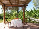 Pergola with hammock and views to tropical gardens
