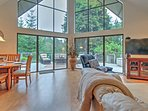 You can admire the wooded view from the floor-to-ceiling windows .