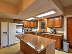 Prepare a home-cooked masterpiece in the fully equipped kitchen.