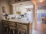 Fully equipped kitchen with seating for 3 at the brekffast counter, standard coffee maker, dish washer & dinette with...