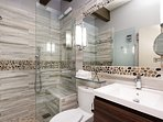 Luxurious brand new master bathroom with heated floors.