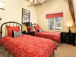 Beautiful 2nd bedroom has twin beds with down comforters and pillows