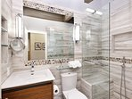 Stunning brand new hall bathroom with heated floors.