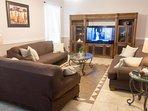 Family room, three sofas plenty of space for 10. 65' tv with soundbar and sub.