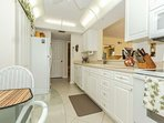 Galley kitchen, with all the conveninces you need to prepare meals for family and guests.
