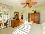 The master bedroom offers direct access and a beautiful view of the peaceful, fully screened, lanai.