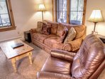 Living Room - Over sized living room featuring a microfiber sofa, leather recliner, gas fireplace, flat screen TV and...