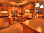 Kitchen - The kitchen features granite counters and new stainless steel appliances.