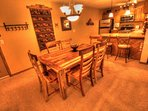 Dining Room  - The dining room table seats up to 6 people comfortably, and there are 2 additional seats at the bar.