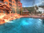 Main Pool - Year round outdoor heated pool. Built in water slide and waterfall! Great rock motif.