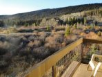 Enjoy the outdoors - On your large deck with grill.  The view faces the 10-mile range which looks stunning in the...
