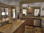 Kitchen - The kitchen features granite counters and stainless steel appliances.