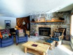Fireplace - This is a GREAT wood-burning fireplace made of authentic river stone that is a fitting centerpiece to this...