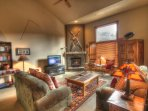 SkyRun Property - '2336 Red Hawk TwnHms' - Living Room - Living room features vaulted ceilings and big windows, new...