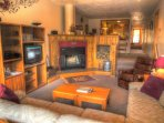 SkyRun Property - '2062 The Pines' - Living Room - The recessed living room has a real wood burning fireplace with free...