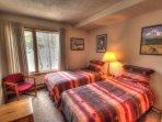 Guest Bedroom - The guest bedroom features 2 twin beds.
