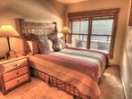 Master Bedroom - The master bedroom features a queen size bed and has fabulous views of the ski slopes.
