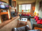 SkyRun Property - '2130 Pines' - Living Room - The living room has 2 queen size sleeper sofas, a new flat screen TV and...