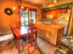 SkyRun Property - '1856 The Seasons' - Dining/Kitchen - There is plenty of room for 6 at this dining room table that...