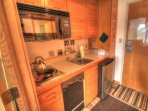 Kitchenette - The kitchenette features a mini fridge, microwave, dishwasher, and 2 burner stove.