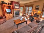 SkyRun Property - '2640 Tenderfoot Lodge' - Living Room - Relax in the living room in front of the gas fireplace, or...