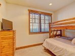 Lower level bedroom with queen and twin bunk bed