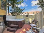 Shared outdoor hot tub just outside the front door