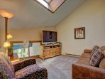Upper level loft with sleeper sofa. It looks out over the living room and is separate from the master bedroom