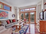 Inviting living room with open treed views!