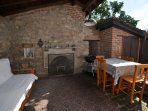 Outside relaxing/dining area with open fireplace, great for cooler evenings