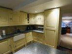 Well equipped kitchen with washing machine, dishwasher, fridge freezer and large range cooker