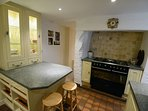 Beautiful kitchen with range cooker leading to the walled garden