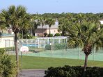 2 Tennis courts, basketball and plenty of green space around the clubhouse.