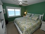 King Size Bed in Master Bed Room looking at the Gulf.  Private Bath adjoins.