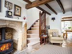 Character filled living room with cosy gas flame stove