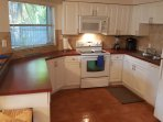 Spacious kitchen with all the amenities you'll need for a beach getaway.