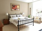 The bright Master bedroom has a fabulous super king-size bed and room for an additional single bed