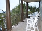 Enjoy the gulf view from the upstairs balcony.