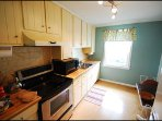 kitchen with modern Electric stove, Microwave, coffee maker, kurig , toaster, fridge