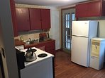 Full Kitchen with small sitting area and access to Sunroom